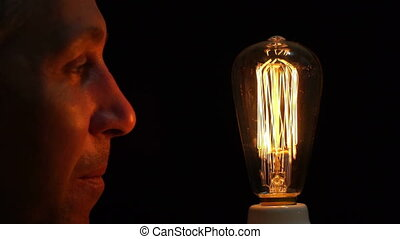 Man Antique Filament Bulb Amusement - Close up side view...