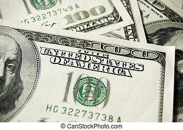 hundreds dollars - many banknotes of hundreds dollars