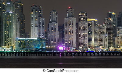 Dubai Marina skyline night timelapse as seen from Palm...