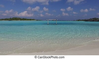 blue sea lagoon with swing on maldives beach - travel,...