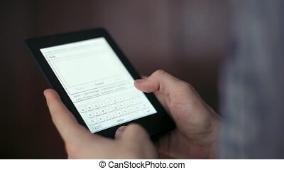 Man Reads an Ebook on His Tablet Write Note - Man Reads an...