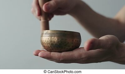 Small Tibetan Singing Bowl Being Made to Sing in Ones Hand.