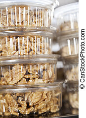 Walnuts In Takeaway Containers At Shop - Walnuts in takeaway...