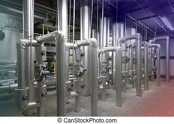 Water treatment plant - metal pipes and shut off valves in...