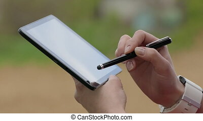 Woman Using Tablet PC Outdoors - Woman Using Tablet PC With...