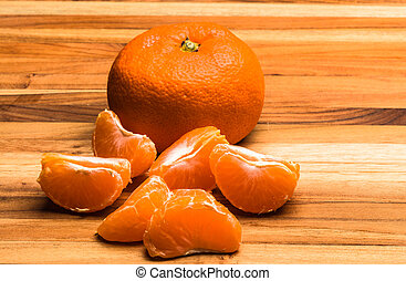 Tangerine Whole and Parted - A whole tangerine and pieces...