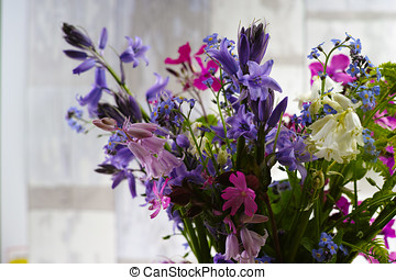 Bouquet with fresh colorful spring forest flowers and hyacinths