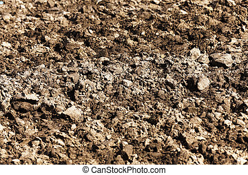 land plowed field - a tractor plowed field agricultural land...