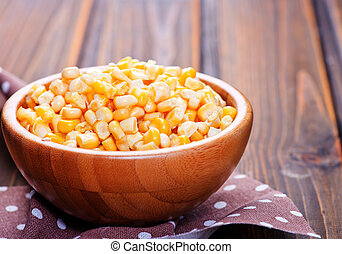 yellow corn in bamboo bowls and on a table