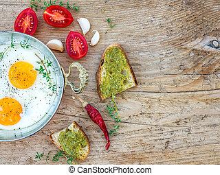 Breakfast set with fried egg on a wooden desk - Country...