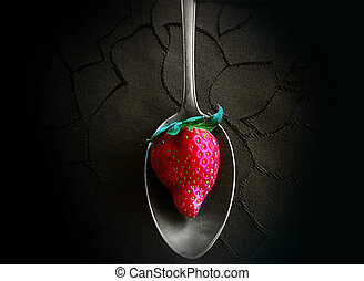 silver spoon with red strawberry