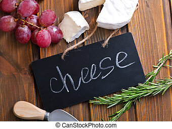 cheese and grape on the wooden table