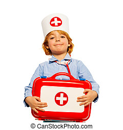 Young boy with medical cap and toy first-aid kit - Close-up...