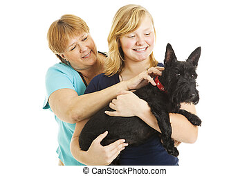 Mother Daughter and Dog - Mother, teen daughter, and...