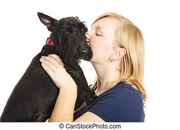 Kisses for Puppy - Teen girl giving kisses to her adorable...