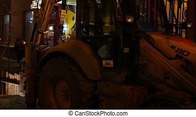excavator working at night