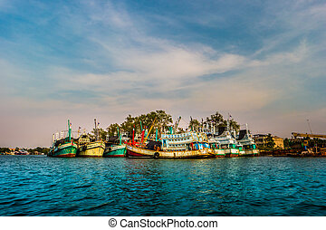 Group of colorful fishing boats at sunset
