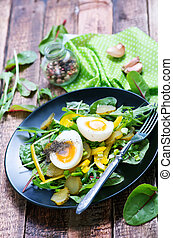 salad with eggs on plate and on a table