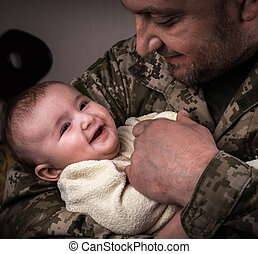 Kids Against War. The child in the arms of a soldier.