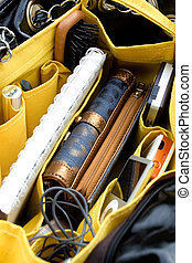 woman bag organizer - inside look of a woman bag with a...