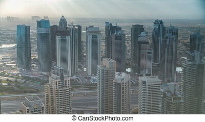 Morning in Dubai Marina with towers and traffic on road from skyscrapper, Dubai, UAE timelapse 4K