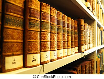 old books in library - old yellow vintage books in library...
