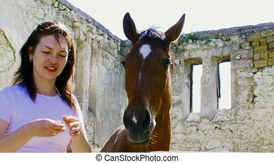 Funny girl and horse