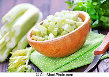 celery in bamboo bowl and on a table