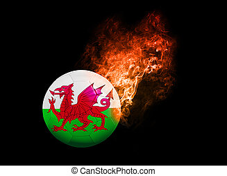 Flaming Football Ball on black background flag Wales -...