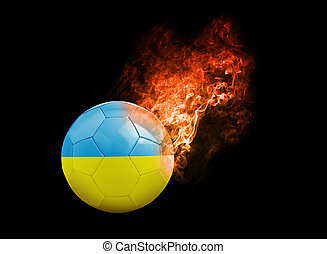 Flaming Football Ball on black background flag Ukraine -...
