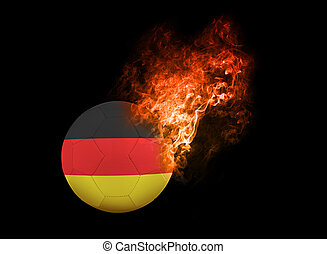 Flaming Football Ball on black background flag Germany -...