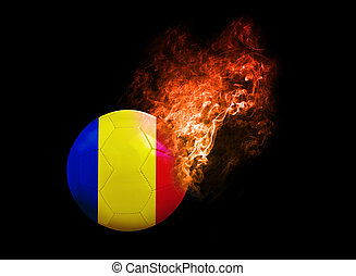 Flaming Football Ball on black background flag Romania -...