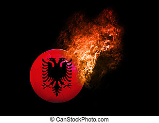 Flaming Football Ball on black background flag Albania -...