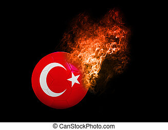 Flaming Football Ball on black background flag Turkey -...