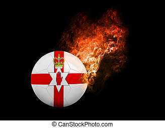 Flaming Football Ball on black background flag North Ireland...