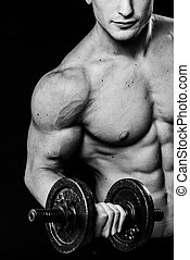 Close up of muscular bodybuilder guy doing exercises with...