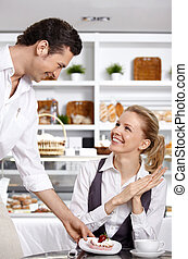 The happy girl - The waiter has brought to the girl a...