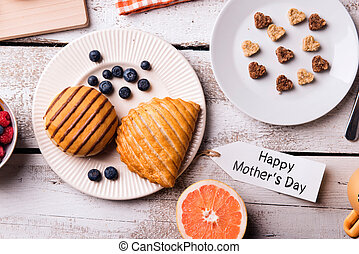 Breakfast with Happy Mothers Day tag. Studio shot. -...