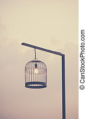 Bird cage decorated as outdoor light post Vintage image...
