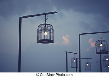 Bird cage decorated as outdoor light post. Vintage image...