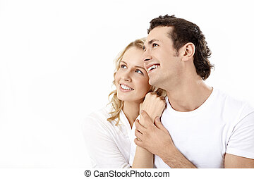 Enamoured couple - Couple having embraced look afar on a...
