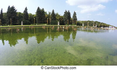 Pond with fountain in park