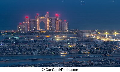 Night to day timelapse view on luxury higlighted hotel on palm Jumeirah in Dubai, UAE.