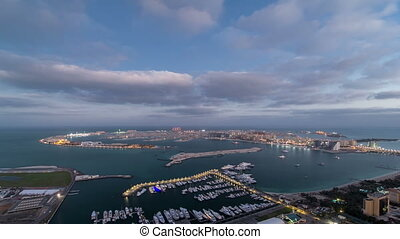 Jumeirah Palm Island night to day timelapse dubai shot from the rooftop top of the tower in dubai marina, uae