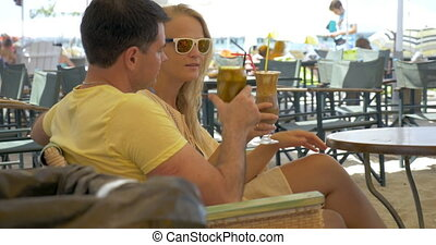 Couple Having a Date in Outdoor Cafe - Young couple is...