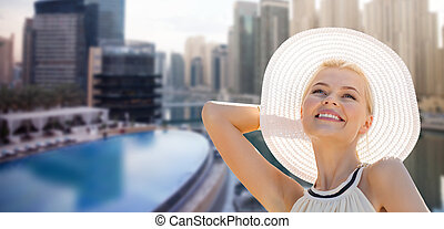 happy woman enjoying summer over dubai city - people, summer...