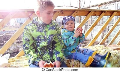 children sit in the gazebo and eat