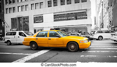 Yellow cab in Manhattan with black and white background The...
