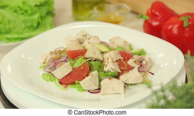 Fresh salad with orange and chicken fillet - Presentation of...