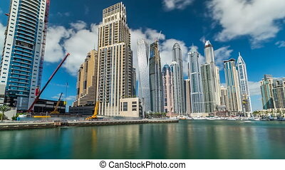 View of Dubai Marina Towers and canal in Dubai timelapse...